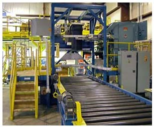 Bulk bag filler station with take away roller Conveyor. Includes controls, walkways and handrails.
