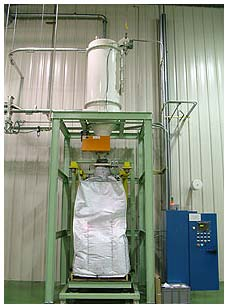 Bulk Bag Filler located under pneumatic receiver - loading carbon black dust from dust collectors.