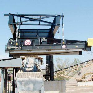 electromagnet over aggregate conveyor belt side view