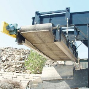electromagnet over aggregate conveyor belt front view