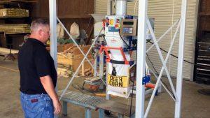 deer corn bagging machine over roller conveyor