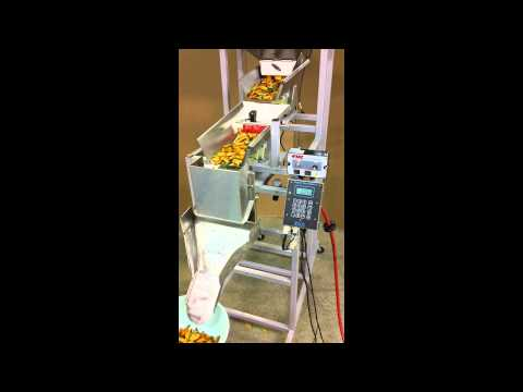Food Filling Machine: Logical Machines Model S-6 running 170g mixed vegetable chips