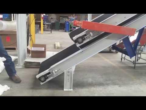 Bag Flattener Conveyor for Palletizing Bags of Fertilizer