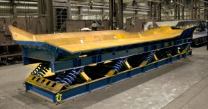 vibrating pan and trough conveyor for hot abrasive materials