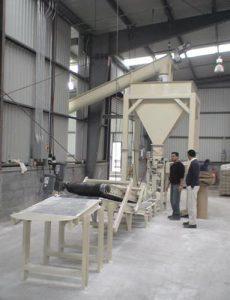 valve bag filling system with conveyor and bag flattener