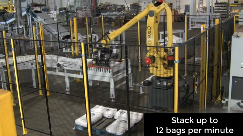 robot stacks bags on shipping pallet