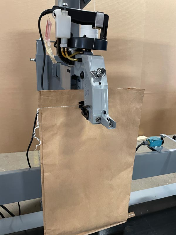 bag sewing machine for closing bags of deer corn and other grains