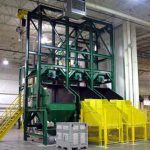 3 bulk bag dispensers with overhead rail hoist and hoppers below
