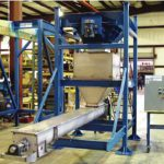 bulk bag dispenser with screw conveyor for material transfer