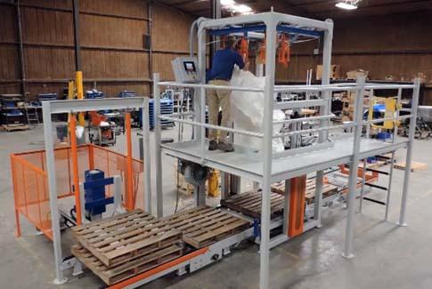 hanging empty bulk bag inside of bulk bag filling system