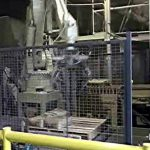 palletizing robot stacking filled bags of cement