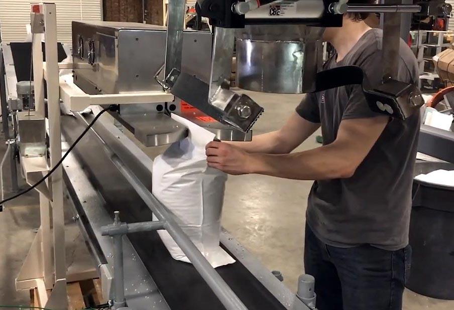Bag Closing Conveyor closes bags filled with Pool Salt