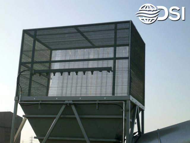 dry fog dust suppression system with wind fences installed on top of a hopper