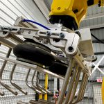 fanuc robot tool picks bag up and rubber boots expand gently to squeeze the bag