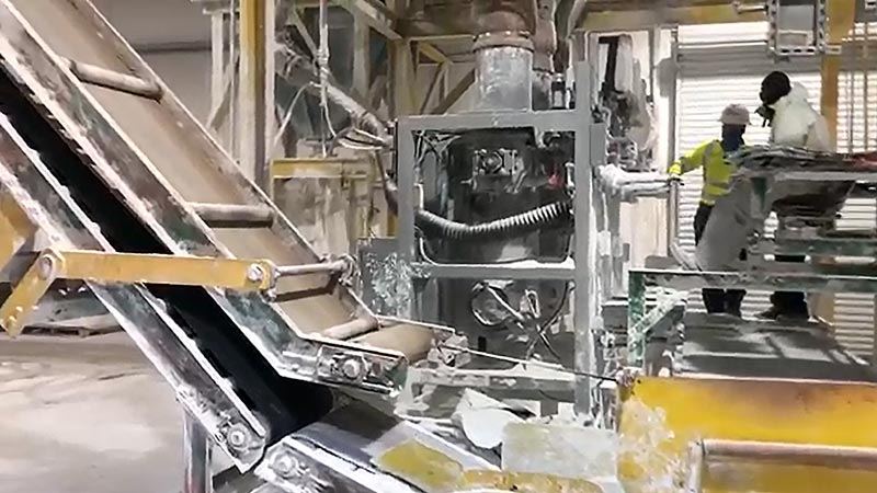One operator filling 50 lb bags with hydrated lime powder