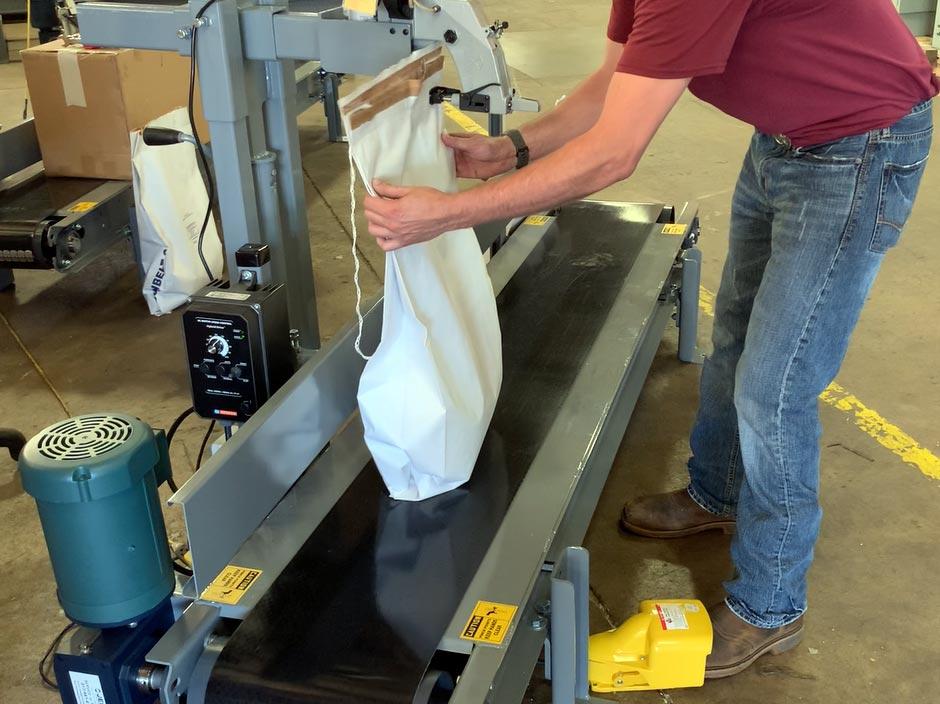 Bag Sewing Machine on a Conveyor