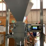 bagging machine attached to a 70 cubic foot hopper