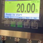 close up of digital scale controller with auto tare