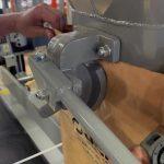 close up of mechanical cam grip bag spout