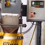 filling bags of grass fertilizer using a digital gross weight bagging scale