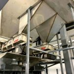 full flow and dribble flow feeders metering material into weigh hoppers