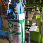 open mouth bag placed on spout by automatic bag placer