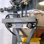 side view of bag filling machine for grass fertilizer using a digital gross weight bagging scale