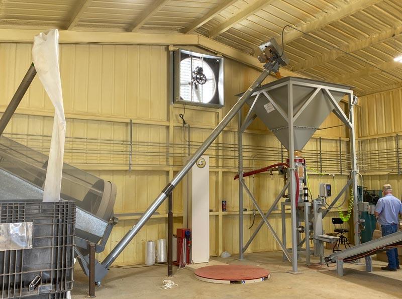 auger conveyor conveys shelled corn into surge hopper