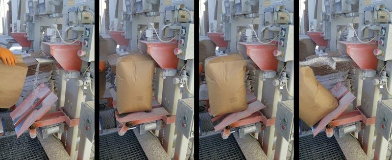 automated valve bag tip and drop onto conveyor