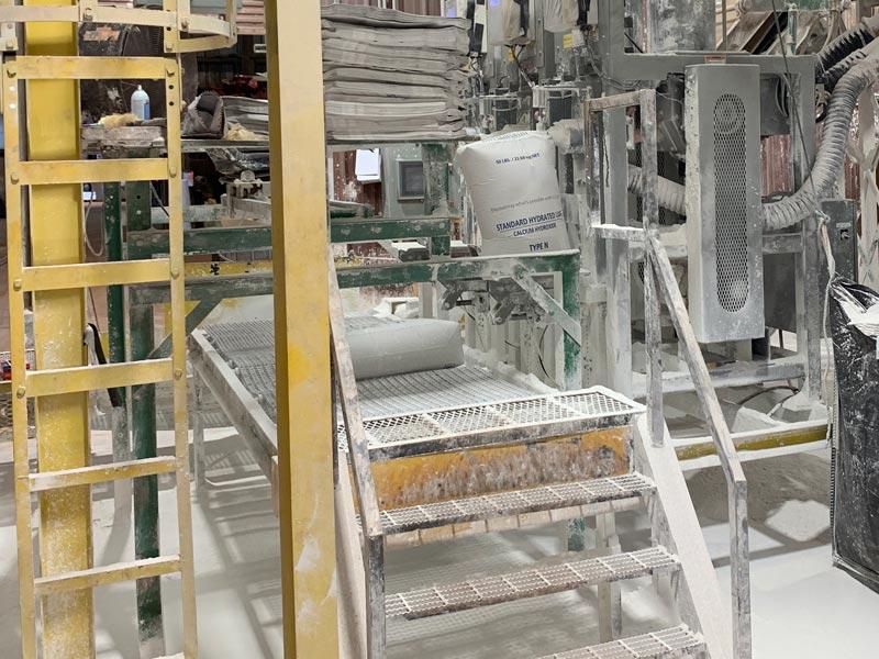 bag discharge conveyor with operator seat