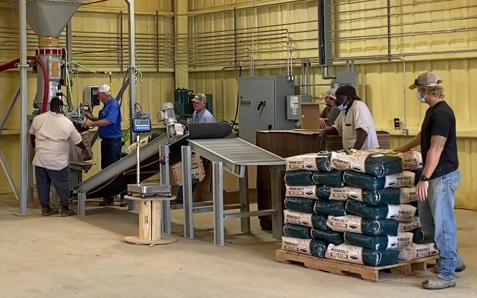 bag incline conveyor to gravity roller table