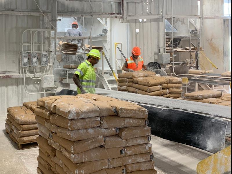 bag transfer conveyor for bags of calcium carbonate