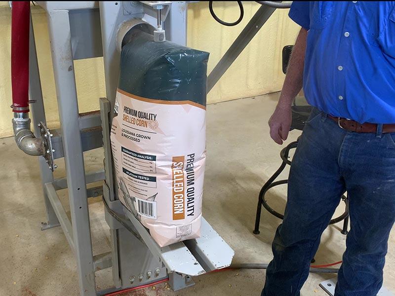 Bagger filling 50 lb. valve bag with shelled corn