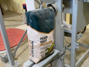 grain bagging system fills 50 lb bags with shelled corn