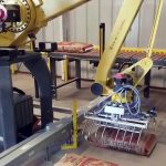 bag palletizing robot picks up and palletizes 50lb bags of creep cattle feed 002