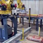 bag palletizing robot picks up and palletizes 50lb bags of creep cattle feed 003