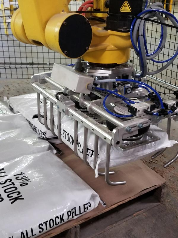 palletizing robot stacking bags of livestock feed pellets