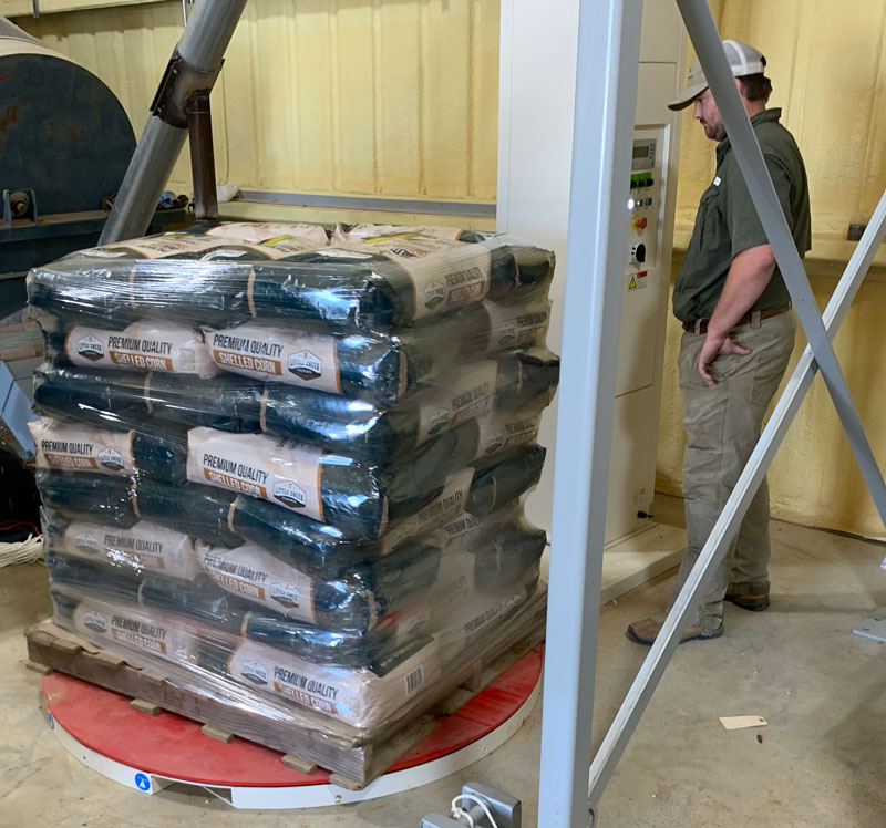 Stretch Wrapping Pallet with Bags of Corn